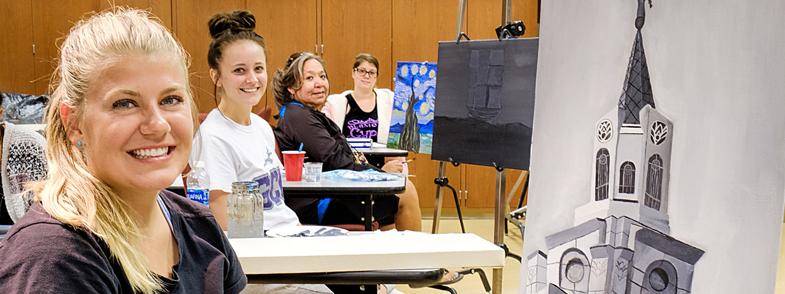 four female students in painting class