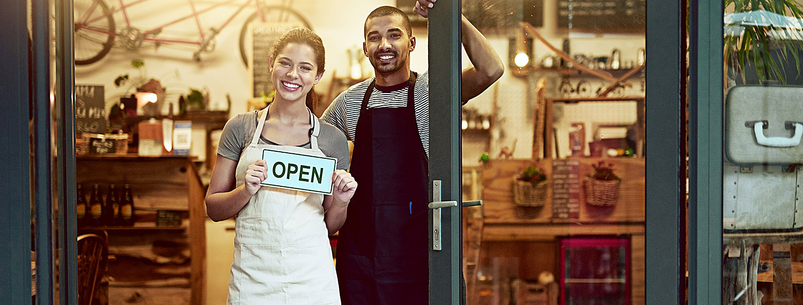 man and woman standing in doorway of new business