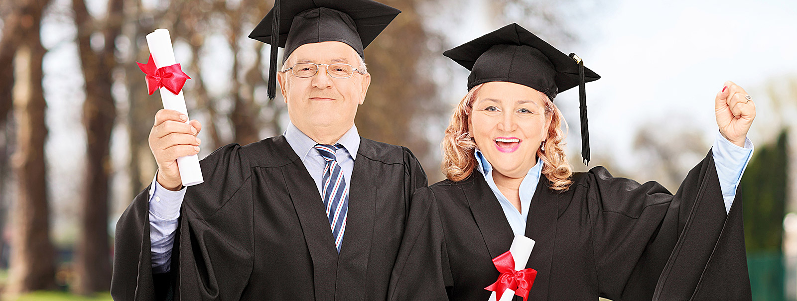 adult students holding diploma
