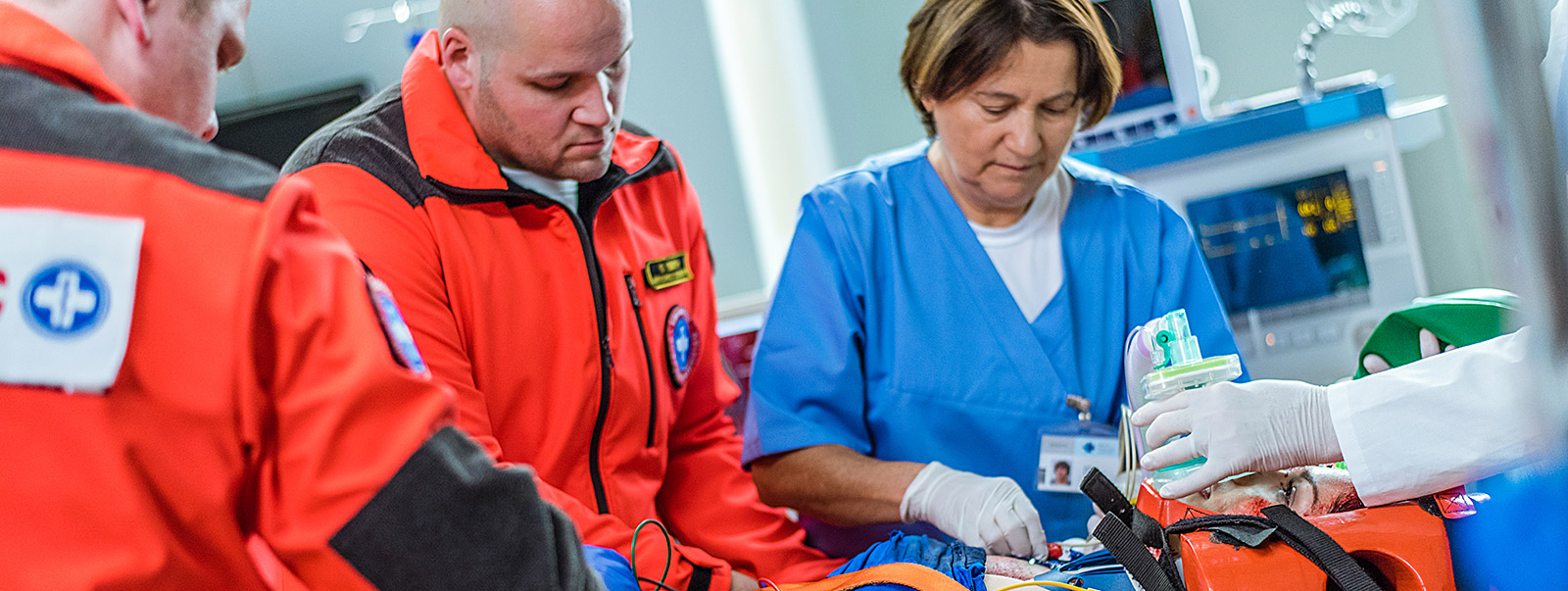 paramedic working with nurse in emergency room