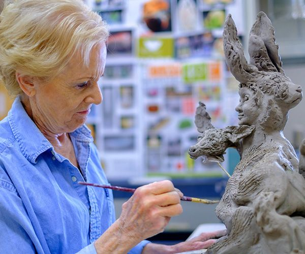 woman working on sculpture