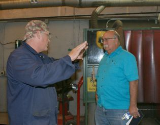 Welding instructor Randy Hoskins, left, and Board Chair Frank Lucero