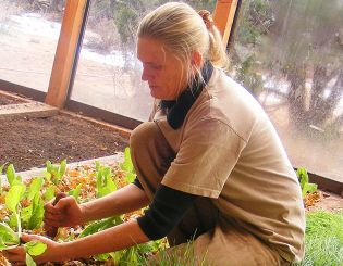 Kim Howell-Costion in her greenhouse garden