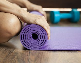 rolling up yoga mat