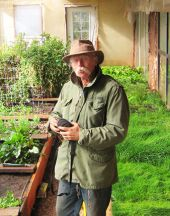 Joe Costion in one of his solar greenhouses.