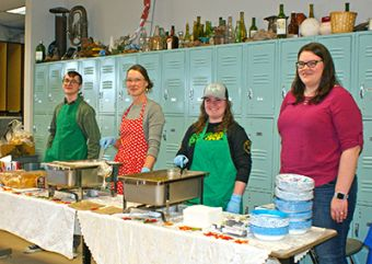 Magda Gluszek (red apron) and volunteers served up hot soup and bread to hungry participants.