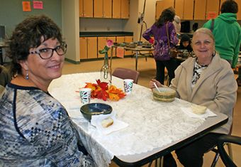 Stephanie Mecimore and Kay Soto enjoy their meal after picking out their favorite bowls to take home.