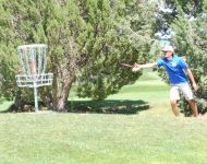 disc golfer shots for the basket